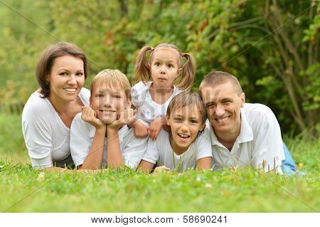 Happy family in summer park