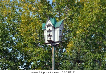 Wooden Birdhouse High Up Among The Trees