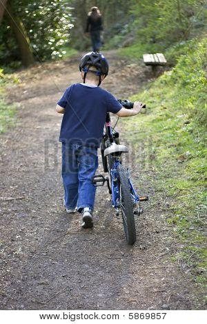 Boy Pushing Bike