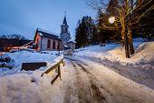 stock photo of italian alps  - Church in the Village of Madonna di Campiglio in the Morning Italian Alps Italy - JPG