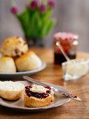 Scones Prepared With Clotted Cream And Jam