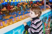 image of funfair  - Little boy of three years at a funfair outdoors - JPG
