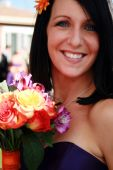 stock photo of matron  - Beautiful maid of honor with her colorful bouquet - JPG