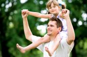 image of piggyback ride  - Father Giving Daughter Piggyback Ride Outdoors - JPG