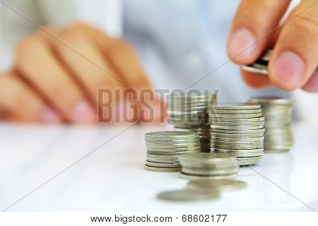 Hand holding coin stack