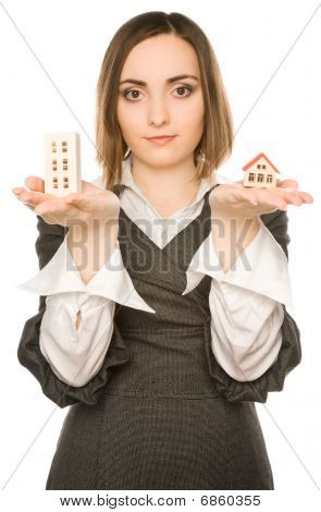 Picture Of A Young Woman Offering Two Buildings