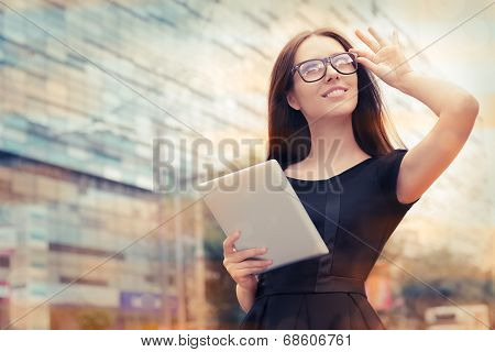 Young Woman with Tablet Out in the City