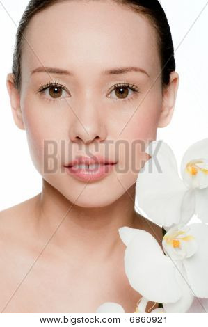 Young and Attractive Woman With Flowers