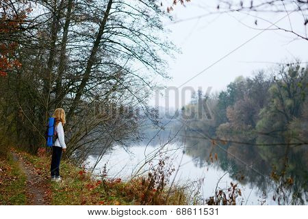 Woman Traveler On The Coast Of Forest River