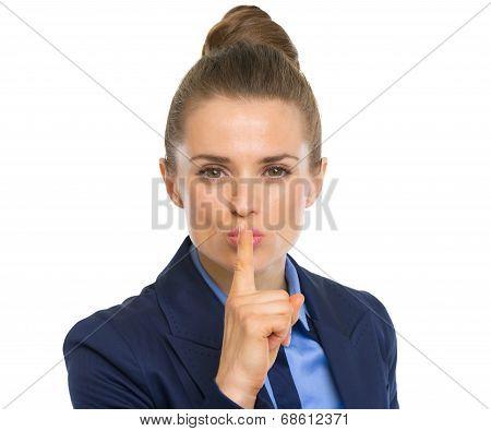 Portrait Of Business Woman Showing Shh Gesture
