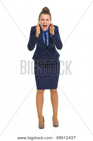 Full Length Portrait Of Angry Business Woman Shouting Through Me