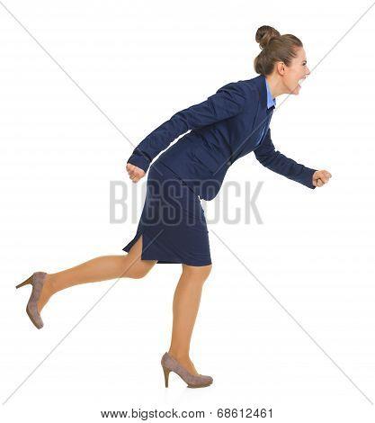 Full Length Portrait Of Smiling Business Woman Running