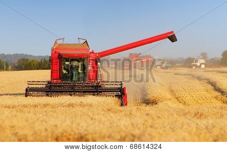 Harvester Machine On Wheat Field
