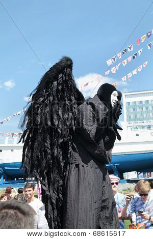 Perm, Russia - Jun 15, 2013: Black Angel On Stilts. Million People Visited Festival Town White Night