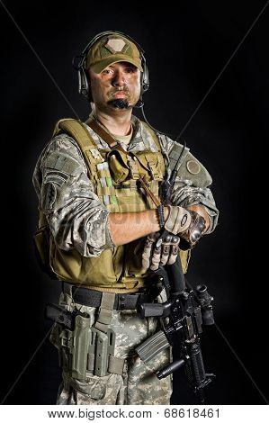 Soldier posing with a gun