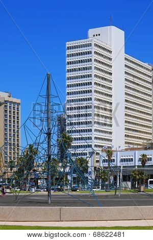 TEL AVIV, ISRAEL - MAY 2, 2014: Beautiful Tel Aviv promenade. On the green lawn in front of the hotel playground attraction