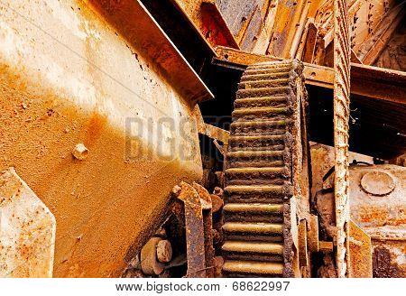 Old Rusty Gear Wheel In Abandoned Factory