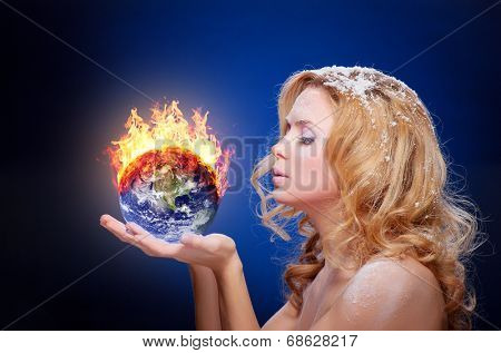 Frozen girl holding burning earth globe (west hemisphere) in palms (elements furnished by NASA) - version with glowing