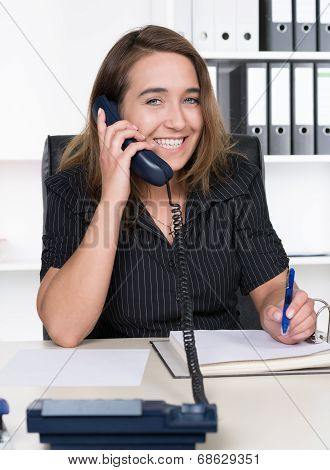 Young Woman Is Phoning In The Office