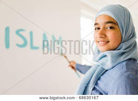 Arabic Muslim girl writing messages on board