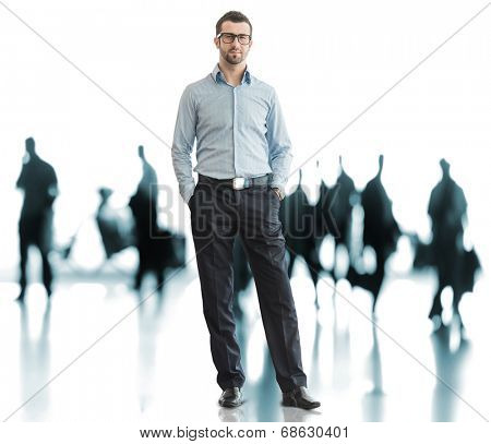 Business man standing on airport with traveling people in background