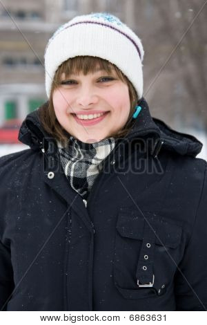Smiling Young Girl In Winter Day