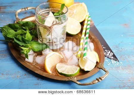 Fresh ingredients for mojito on old tray