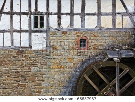 Watermill At Stone Wall Of Old House