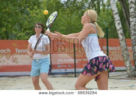 MOSCOW, RUSSIA - JULY 17, 2014: Olga Barabanschikova (in front) and Natalia Zvereva of Belarus in the match with China during ITF Beach Tennis World Team Championship. Belarus won the round 3-0