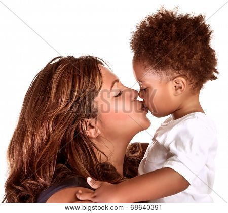 Portrait of cheerful mother kissing baby, studio shot, happy motherhood, lovely African family, happiness and love concept