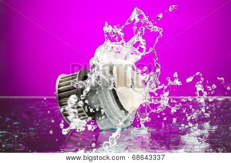 Auto Parts, Engine Cooling Pump In Spurts Of Water On Purple Background