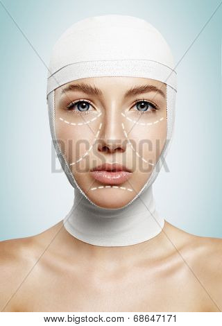 Pretty Woman With Bondaged Head And Surgery Lines