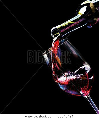 Wine. Red wine pouring into a wine glass. Isolated on black background. Border art design
