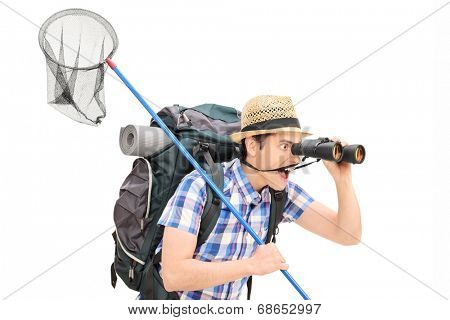 Guy with butterfly net looking through binoculars isolated on white background