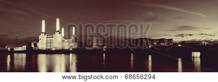 Battersea Power Station panorama over Thames river as the famous London landmark at night.