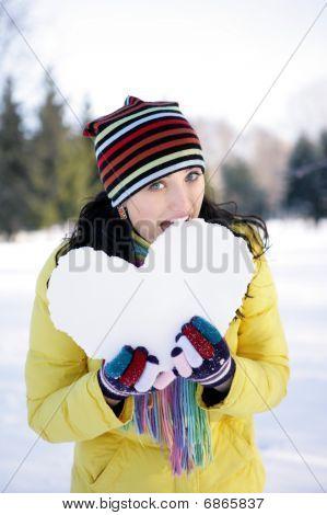 Girl bitten snowy heart