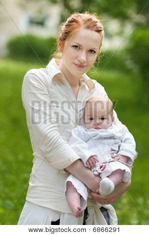 Young Mother And Her Baby Girl