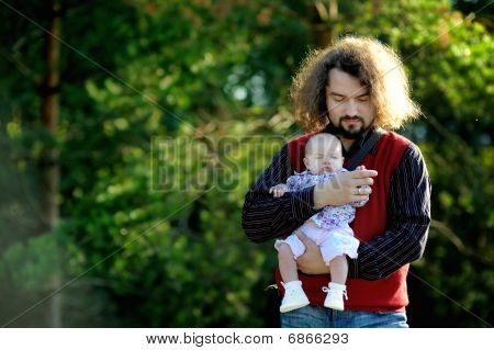 Young Father And His Little Baby