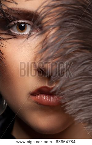 Portriat Of Woman With A Feather At Her Eye