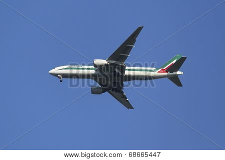 Alitalia Boeing 777 in New York sky before landing at JFK Airport