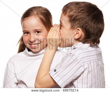 Boy whispers girl in the ear secret. Childrens gossip