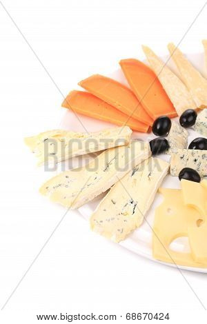 Cheeseboard with black olives.