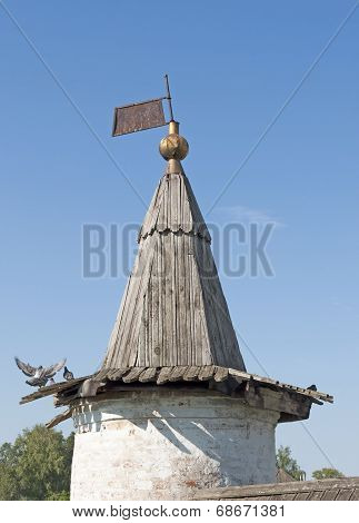 Old Tower With A Wooden Marquee In Ancient Monastery