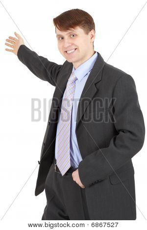 Hospitable Businessman In A Business Suit On White Background