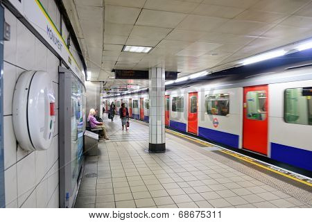 LONDON, UK - SEP 27: London Underground station interior on September 27, 2013 in London, UK. The system serves 270 stations, 402 kilometers of track with operation history of 150 years