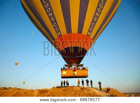 GOREME, TURKEY - AUGUST 25: Hot air balloon fly over Cappadocia on august 25, 2013 in Goreme, Cappadocia, Turkey