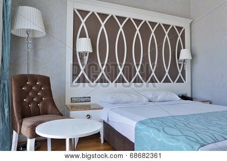 OLUDENIZ, TURKEY - MARCH 30, 2014: Interior of a bedroom with double bed in Ocean Blue High Class Hotel. This 4 star hotel offer to the guests 68 rooms, swimming pool, restaurant, and other features
