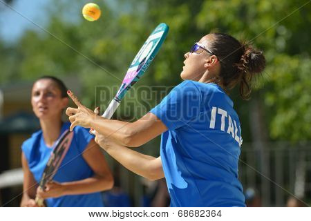 MOSCOW, RUSSIA - JULY 20, 2014: Federica Bacchetta (in front) and Sofia Cimatti of Italy in the final match against Brazil during ITF Beach Tennis World Team Championship. Italy won 2-0