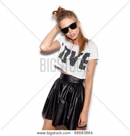 Young Woman With Sunglasses Looking At The Camera