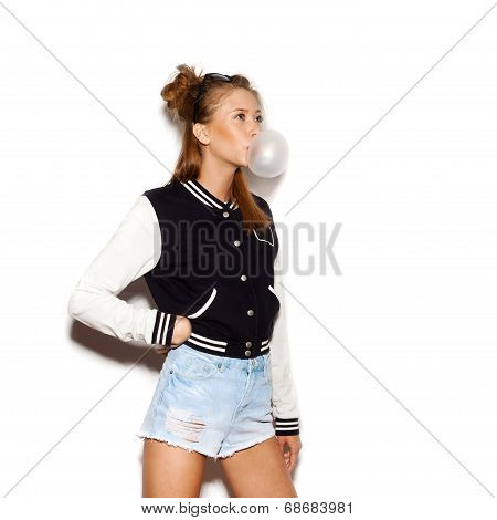 Beautiful Teen Girl Inflating Bubble Of Chewing Gum. Modern Fashion Girl
